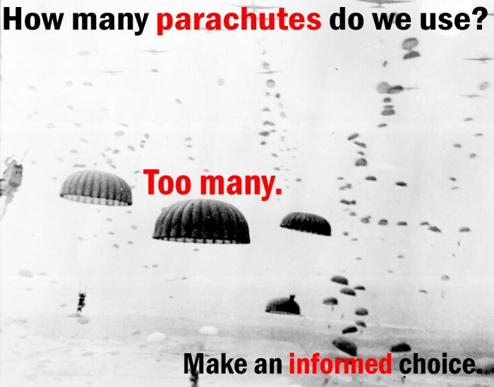 Parachutes open overhead